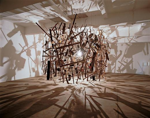 Cornelia Parker, Cold Dark Matter: An Exploded View, 1991. A garden shed and contents blown up for the artist by the British army, the fragments suspended around a lightbulb. Varying dimensions. Courtesy of the artist and Tate Gallery