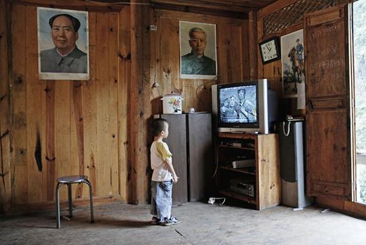 "Portraits of late Communist Party leaders are still common decorations in the homes of many peasants. In spite of their sufferings during the Great Chinese Famine (1958–1961) and the Cultural Revolution, many elderly peasants consider the past a better time and complain about worsening ubiquitous corruption and inequality. Patriotic TV programs depicting the founding of the ""New China"" have not lost their attraction. (Photos top to bottom: Yunnan Province and Hunan Province)"
