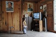 Portraits of late Communist Party leaders are still common decorations in t...