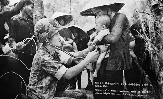 """Caption reads, """"Members of a mobile treatment team of the Blue Dragon brigade take care of Vietnamese villagers"""" (ROKFV 1968: 70)"""