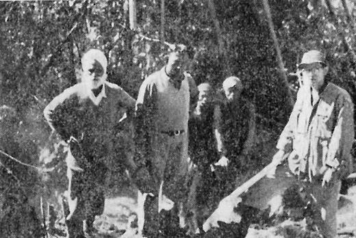 Itō Hiroichi (far right), Lal Singh (Indian technician, far left), and members of the Toungoo road construction crew (Itō 1963: 113; photographer unknown; photo by Nippon Kōei or Iwanami Eiga Seisakujo, which provided the pictures for Itō's book [203])