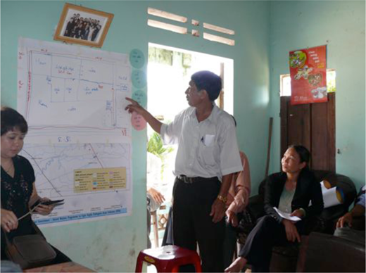 Participants discuss a map illustrated on butcher paper rather than the pre-supplied GIS map and key. Photo by author.