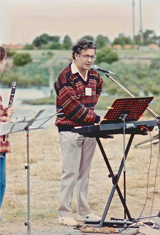 "Chester Schultz introduces communal singing of the traditional ""Down by the Riverside"" at Mangrove Creek on 13 April 1996. Image courtesy Geoff Willsmore."