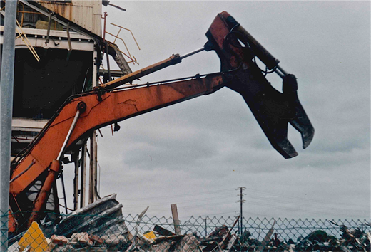 One of the huge machines of demolition at the CSR Sugar Refinery at Glanville, January 1993. CD booklet image, courtesy Chester Schultz.