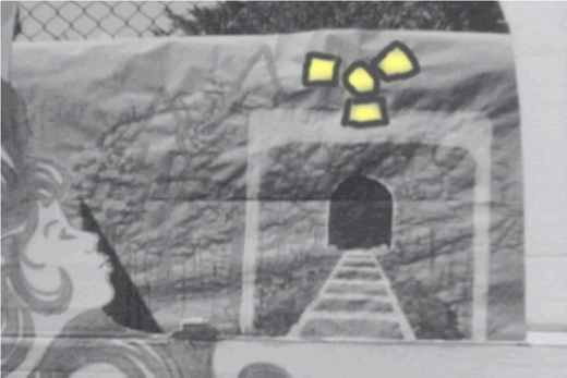 Past Elliot Lake at a mineshaft with a blinking radiation symbol.