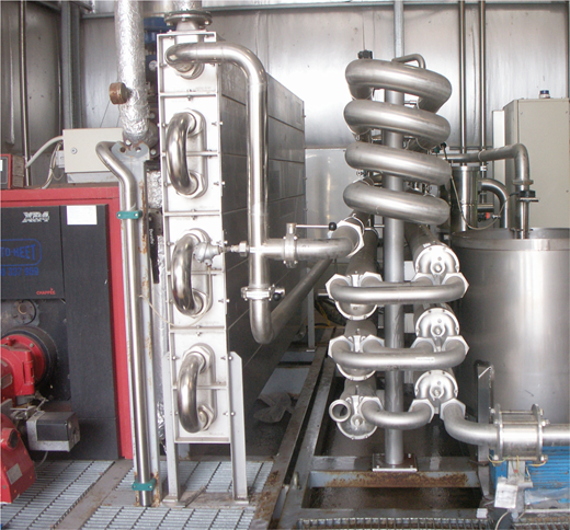 The winery's pasteuriser. Wine enters the machine through the piping on the right and is pumped into a heat exchanger (centre). The pipes within the heat exchanger are surrounded by water, heated in a large boiler (left), which warms the wine to 72°C. On reaching 72°C, the now-pasteurised wine is rapidly cooled before exiting the machine. Photo by author.
