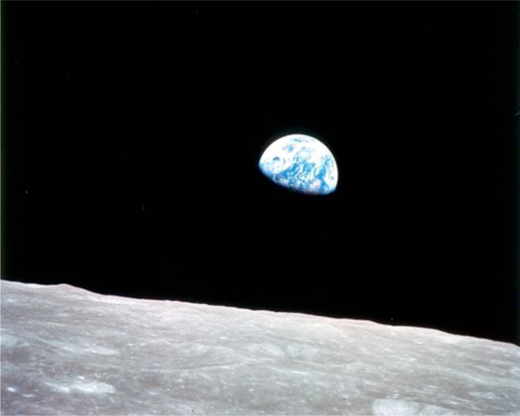 """Earthrise"" Note that the original image was tilted in publication to this familiar landscape mode, with a lifeless moon replacing the familiar foreground of earthbound horizons. Image courtesy of NASA."