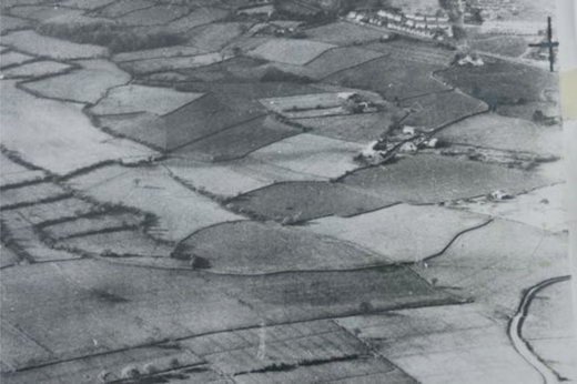 An aerial photograph of the old farm in Wales: the house and farmyard are near the centre; the farm itself fills the left and bottom of the picture (date unknown, but pre-1977).