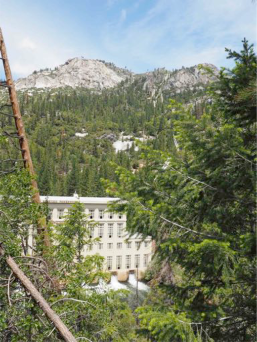 Big Creek Power House No. 1, which went into operation in 1913. The penstocks—high-pressure pipes carrying water from upstream reservoirs—can be seen on the mountainside above and just to the right of the power house. Photograph by author.