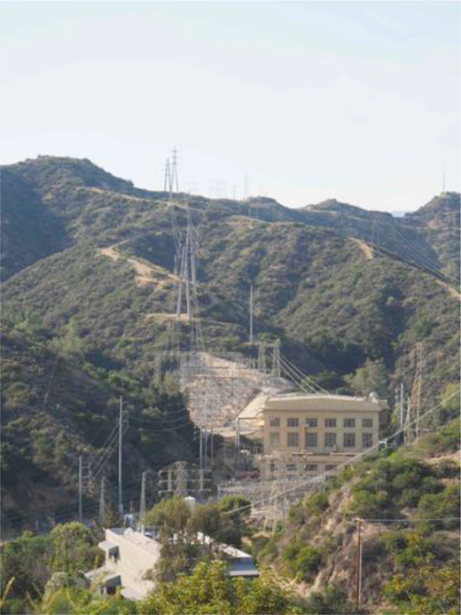 Eagle Rock Substation near Pasadena, California. The transmission lines from Big Creek are in the background running up the hill; lower-voltage distribution lines heading toward Los Angeles can just be seen at the lower left-hand corner of the image. Photograph by author.