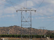 A red-tailed hawk landing on one of the Big Creek transmission towers near ...