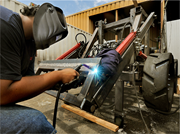 A worker replicates the OSE tractor in <b>California</b>. Image courtesy of Open S...
