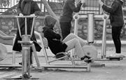 Women using outdoor gym equipment in Cumhuriyet Park. Faces are not exposed...