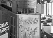 Amanda Gris anthology <b>advertised</b> on the side of a skyscraper   Figure 3. Am...