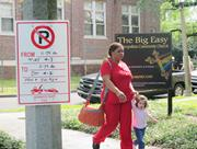 """No Parking"" sign identifies a film production location <b>on</b> busy Carrollton ..."