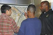AEC soldier demonstrates the power of the global base locator to <b>young</b> visi...