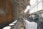 Wall of books-print wallpaper by Deborah Bowness run floor to ceiling, inte...