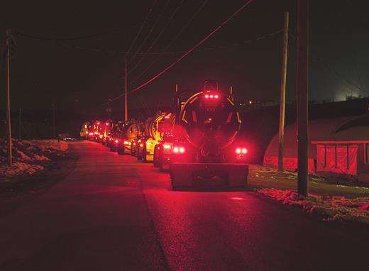 Water trucks lining up at night at a water intake system in Wyalusing, PA. Photograph by Nina Berman