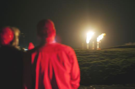 Methane flares from shale gas wells in Springville, PA. Photograph by Nina Berman