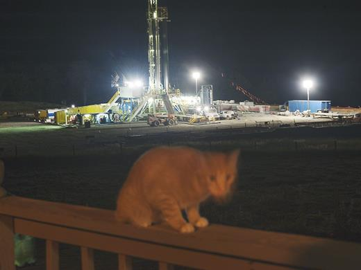 The view from a porch overlooking a drilling rig on a neighbor's dairy farm in Rome, PA. Photograph by Nina Berman