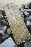 A gravestone unearthed from the Surp Hagop Armenian cemetery laying upside ...