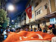 A group of young men walking the neighborhood bring a giant flag to Mehmet ...
