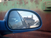 Rearview mirror of my parents' VW showing the Ali Ibn Abu Taleb <b>mosque</b> in S...