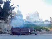 Burning trash dumpster in Beit Hanina. Trash is <b>often</b> burnt when it is not ...