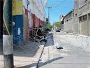 Military curfew in downtown Kingston, 2010. Photo by author.   <b>Figure</b> 1. Mi...