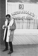 Baldwin in front of Muhammad's Mosque no. 34 in Durham, North Carolina, <b>now</b>...