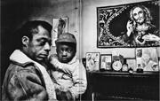 Baldwin holding an abandoned child in Durham, <b>North</b> Carolina, under the gaz...