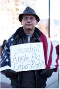 A <b>protester</b> in Madison rallies against Wisconsin Governor Scott Walker's at...