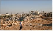 Even amid Israeli attacks like the one that turned these <b>three</b> homes to rub...