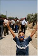A <b>child</b> marches to the Separation Wall in Bil'in, taking part in a nonviole...
