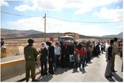 Palestinian <b>women</b> wait at a checkpoint in Nablus, West Bank, on their way t...