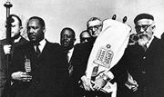Martin Luther King Jr., Abraham Joshua Heschel, and Rabbi Maurice Eisendrat...