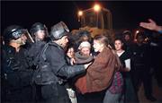 Kobi Gideon/Flash90  An Israeli woman rebukes Israeli soldiers in January 2...