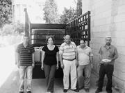 Deborah Kaufman  A Palestinian moving crew from Al-Quds helps Deborah Kaufm...