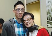 AP Photo/Paul Sakuma  Steve Li embraces his mother after a news conference ...
