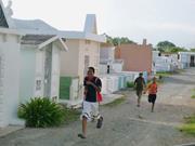 Deepak Lamba-Neives  The construction of Boca Canasta's <b>water</b> tower (left),...