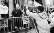Portia Baladad ( portiabaladad.com )  An anti-abortion protester brandishes...