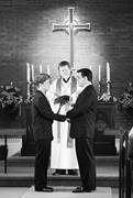 AP Photo/Mitch Jacobson  Two men exchange legally unrecognized wedding vows...