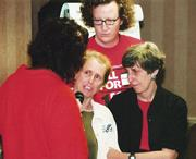 Courtesy of NCBI  Cherie Brown (right) facilitates a workshop at the Nation...
