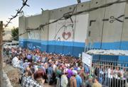 Andrew Larsen ( andrewlarsenphotography.com )  Palestinians line up at Chec...