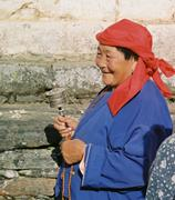 Creative Commons/Anja Disseldorp  Bhutan residents such as this woman from ...