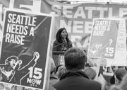 Yemane Gebremicael (right) urges SeaTac residents to <b>support</b> local business...