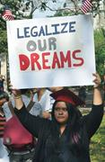 Flickr&#x2F;Michael Fleshman  A <b>protester</b> at a 2013 rally holds a sign in suppor...