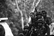Members of a Philippine marine landing team prepare for deployment in the w...