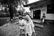 Volunteers <b>leave</b> the rural health center of Datu Odin Sinsuat to conduct th...