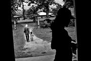 Volunteer health workers, <b>leaving</b> a remote rural unit, make rounds even to ...